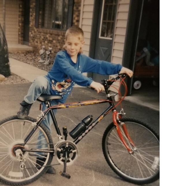 A young Tom Klos rides his bicycle