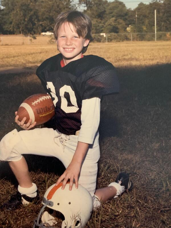 Young Jeff Rogers on the football field